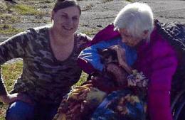 Caregiver smiling with a senior