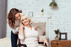 portrait of an old woman and her caregiver